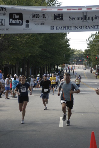 Runners getting ready to cross Finish Line at 2006 Second Empire 5K Classic
